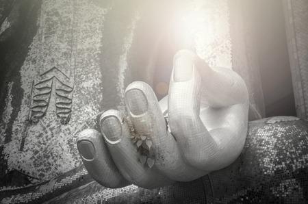 35284095 - closeup the hand of big buddha