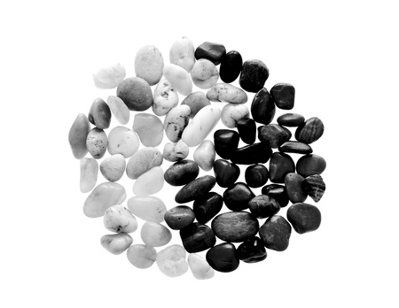 10865802 - yin yang symbol made from beach pebble, isolated on white